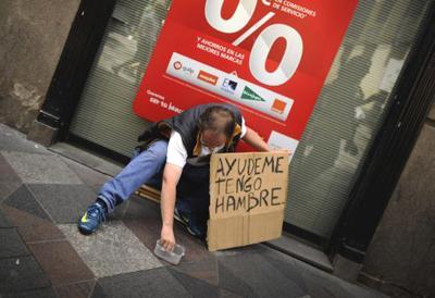 Devant une banque, à Madrid : Aidez-moi, j'ai faim